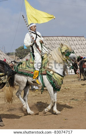 RABAT, MOROCCO - JULY 30: Local riders participate in a traditional fantasia event (or MOUSSEM in Arabic) which is mainly a hobby and sport event July 30, 2010 in Rabat, Morocco. - stock photo
