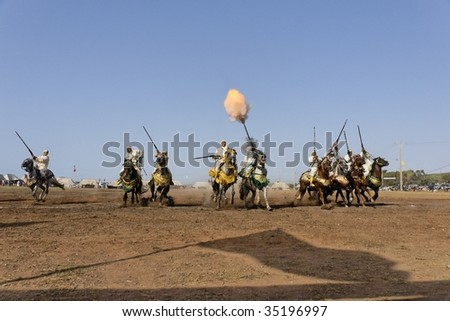 RABAT, MOROCCO - JULY 30, 2009: these riders are participating in the traditional fantasia (MOUSSEM in Arabic) which is mainly a hobby and a sport. - stock photo