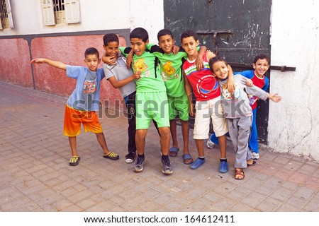 RABAT, MOROCCO - October 15 2013 : Kids in the streets on Eid al-Adha. The festival is celebrated by sacrificing a sheep or other animal and distributing the meat to relatives, friends, and the poor. - stock photo