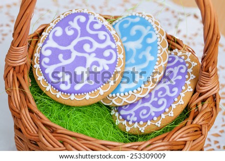 Rabbit and Egg as Easter traditional Gingerbread cookies in basket - stock photo