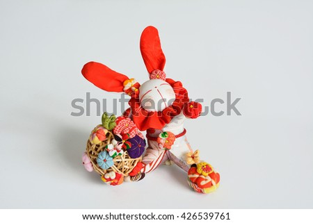 "Rabbit doll by traditional chirimen craft. Chirimen is a silk fabric with a delicate ""wrinkles"", and  the material of the kimono.Together sewing a small remaining fabric, toys has been crafted."