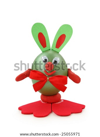 Rabbit made from egg and paper isolated on white background