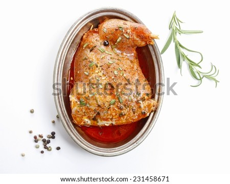 Rabbit meat with herbs isolated on white background - stock photo