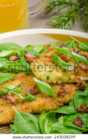 Rabbit steaks with herbs and sour cream, mustard mayonnaise, sprinkled bacon and spring onion, juice serving - stock photo