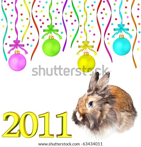 Rabbit (symbol of the new year 2011) and multi-colored dull christmas balls hanging on tapes isolated on white background - stock photo