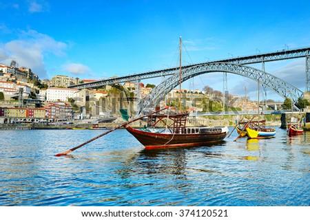 Rabelo boats in front of Dom Luis II bridge in Porto, Portugal - stock photo