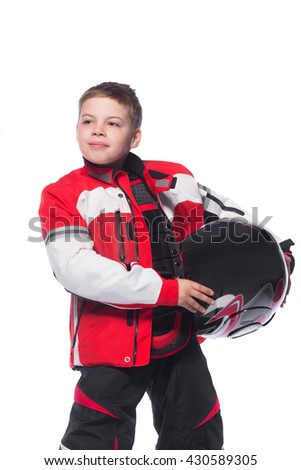 Race car or bike driver. The boy in the costume of the racer holding a helmet and looking at the camera isolated on white background