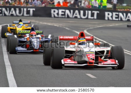 Race cars racing at the grand prix on urban circuit - stock photo
