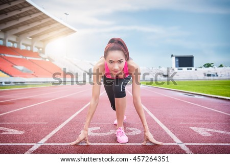 Race Fit And Confident Woman In Starting Position Ready For Running Female Athlete About To