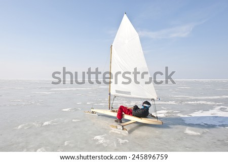 Race of sailing boats on the sea ice in winter