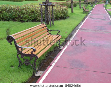 Racecourse with brown wooden chair place on public park - stock photo
