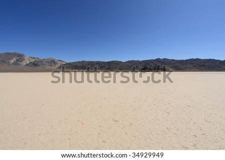 Racetrack playa in death valley-11 - stock photo