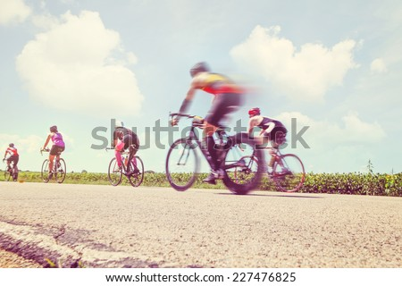 Racing Bicycles. Motion blur. - stock photo