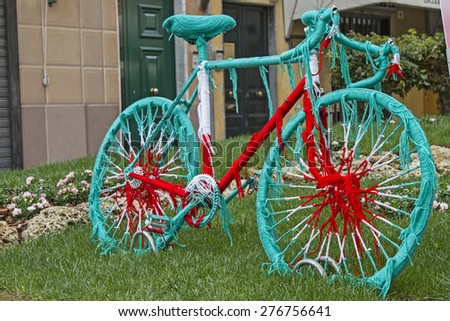 racing bike decorative wrapped with woolen threads in the Italian colors  - stock photo