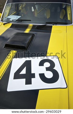 Racing car hood with the number 43 stenciled on - stock photo