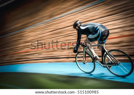 Racing cyclist on velodrome