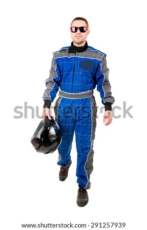 Racing driver posing with helmet and sunglasses isolated in white - stock photo