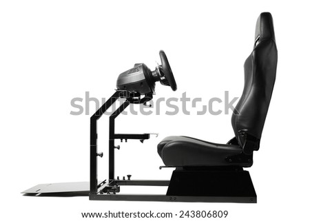 racing simulator cockpit with seat and wheel, isolated on white - stock photo