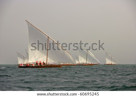 Racing traditional dhows in the Arabian Gulf, off Dubai. - stock photo