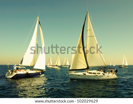 Racing yacht in the mediterranean sea in sunset. - stock photo
