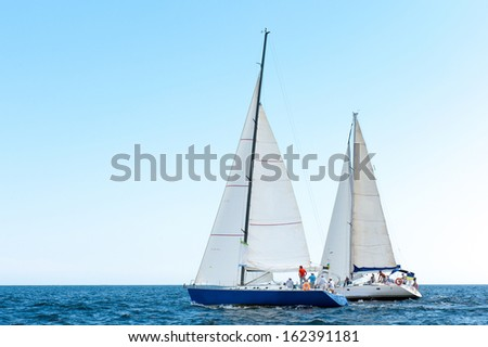 Racing yacht in the Mediterranean sea on blue sky background - stock photo
