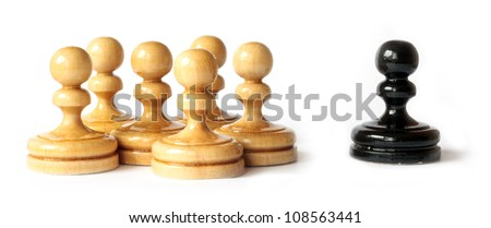 Racism between black and white pawns isolated on white background - stock photo