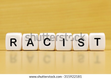 RACIST word on blocks - stock photo