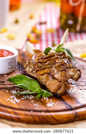 Rack of lamb fried with aromatic olive oil, herbs and spices - stock photo