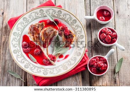 rack of lamb with cherry sauce - stock photo
