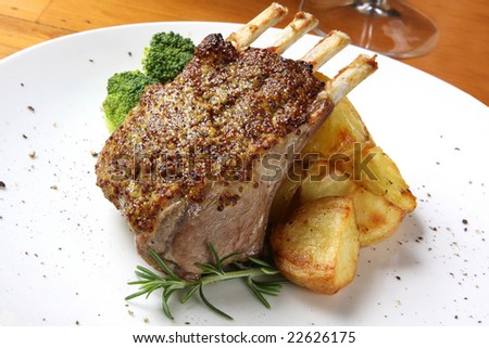 ... lamb with seeded mustard, served with roasted potatoes and rosemary