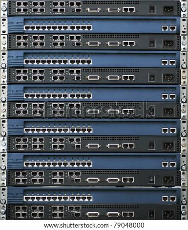 Rack of network equipment - stock photo