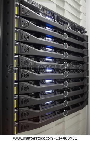 Rack of servers in data center - stock photo