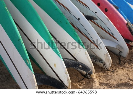 Rack of Surfboards on the Beach - stock photo