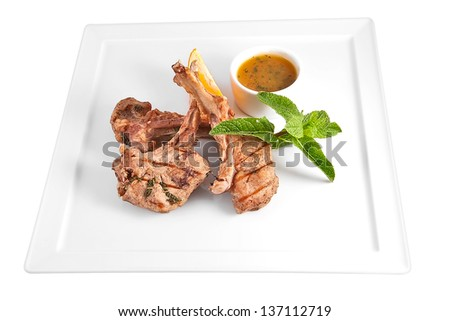 Rack of veal with mint-orange sauce - stock photo