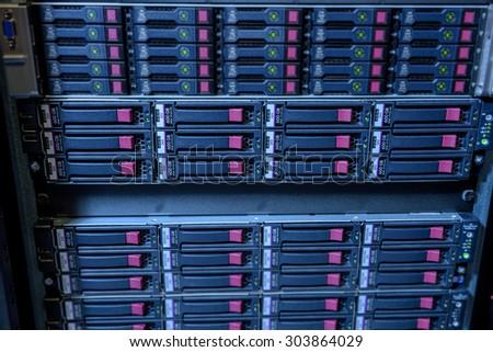 Rack of webserver harddisks in datacenter showing internet traffic - stock photo