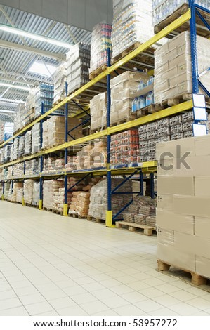 rack stack arrangement of cardboard boxes and goods in a store warehouse - stock photo