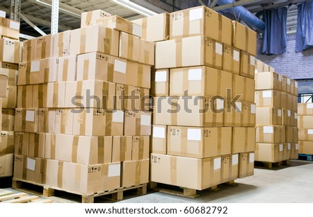 rack stack arrangement of cardboard boxes in a store warehouse - stock photo