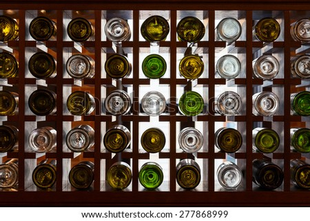 rack with bottles of alcohol - stock photo