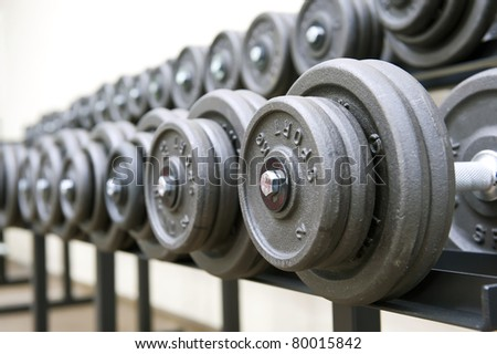 Rack with dumbbells in gym. - stock photo