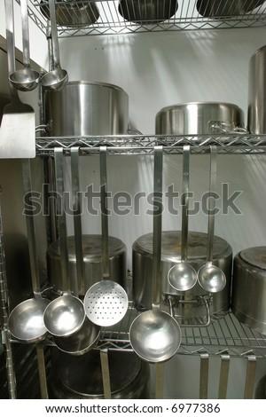 Rack with inox professional kitchen equipment - stock photo