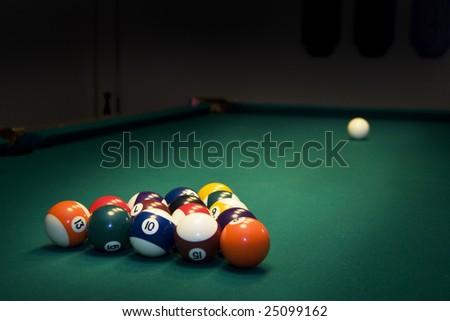 Racked billiard balls, ready for the break - stock photo