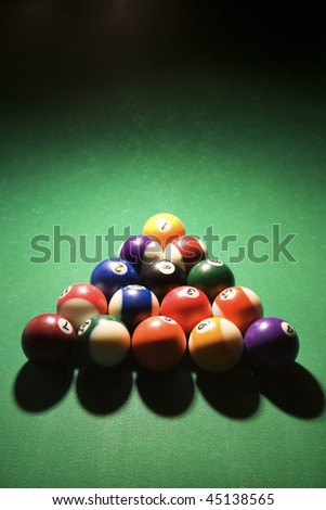 Racked pool balls on pool table. Vertical shot. - stock photo