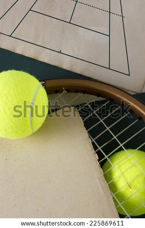 Racket and tennis balls with parchment. Sports equipment. - stock photo