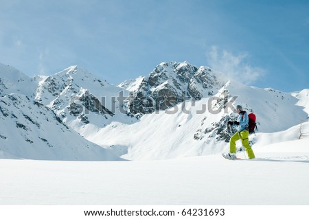 Racket trekking in snow - stock photo