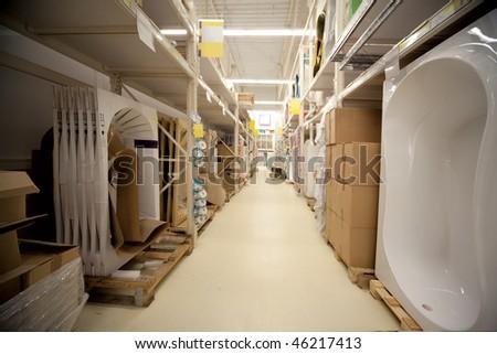 Racks in warehouse sanitary technicians in supermarket - stock photo