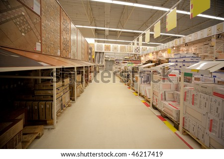 Racks with ceramic tile in warehouse of building materials - stock photo