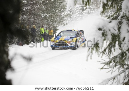RADA, SWEDEN - FEB 10: Per-Gunnar Andersson driving his Ford Fiesta WRC during WRC event Rally Sweden 2011 in Rada, Sweden on Feb 10 , 2011. - stock photo