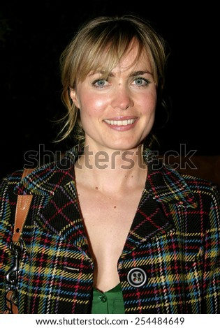 Radha Mitchell attends the Global Green Pre-Oscar Party held at the Day After Club in Hollywood, California on February 24, 2005. - stock photo
