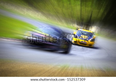 Radial blur in racing car track - stock photo