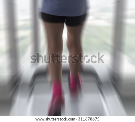 Radial Blur of Unknown woman running in gym like zoom burst motion blur fitness.woman - stock photo